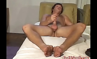 Foot fetish stud jacking off his big dick with passion