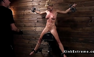 Blonde in bondage gets steers prod in her ass