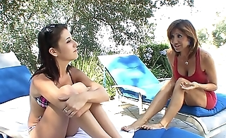 Horny babes Missi Daniels, Tara Holiday take their sexual session into the bedroom