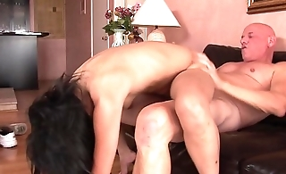 Flexible Asian slut gets pounded by an older guy in the first place the sofa