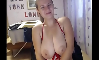 Busty chick keeping moving dildo in pussy