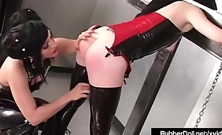 Busty RubberDoll Punishes Slave Girl Diabolica In Stockades!