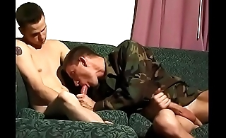 Pair of gay army buddies mess around on the couch